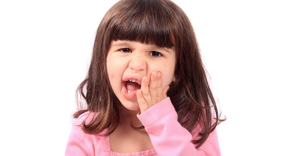 A child experiencing a dental emergency