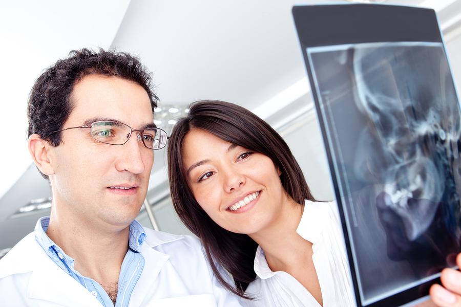dentist examining an X-Ray